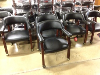 Black Banker Style Chairs On Castors. Price : $169 Each. Color/Finish :  Black And Oxblood Available. Size : N.A.